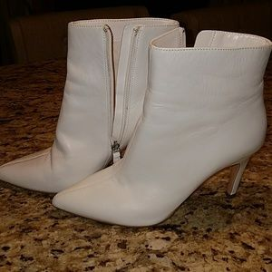 Used white leather booties